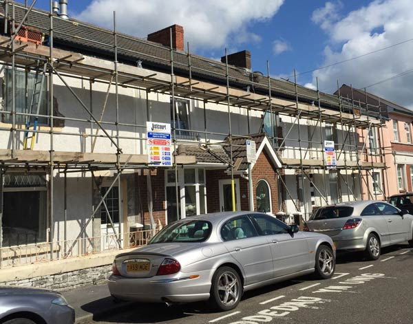 Scaffolding installed on a row of terraced houses