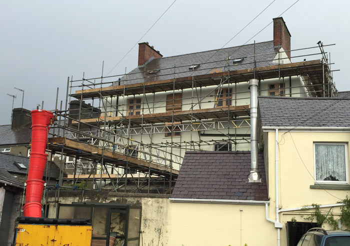 House covered in scaffolding provided by Castle Scaffolding